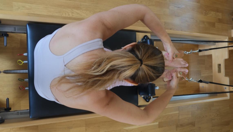Danielle Valens doing Rowing on Pilates Reformer