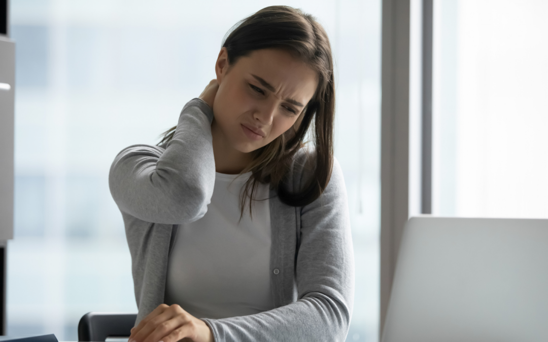 Image depicting girl sitting at desk with neck pain